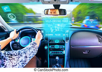 Young woman traveling in self driving car - Young woman ...