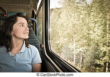 Young woman travelling by train - Young woman passanger...