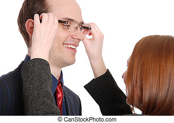 Young woman tries on glasses to the businessman