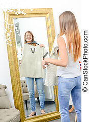 Young woman trying clothes on