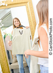 Young woman trying on clothes
