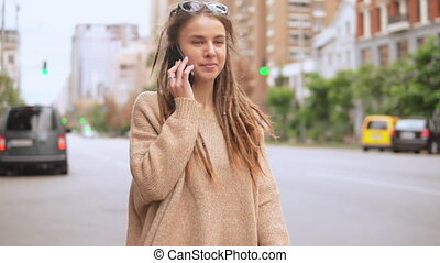 young woman use mobile outdoors - hipster girl talking by ...