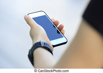 young woman use smart phone in modern city