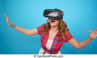 Young woman using a virtual reality headset - Happy young...