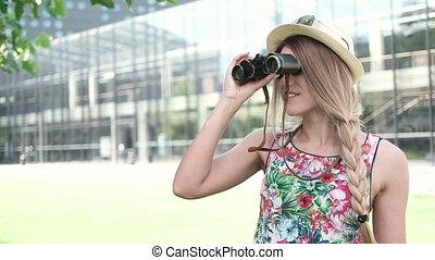 Young Woman Using Binoculars.