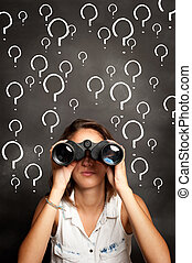 young woman using binoculars