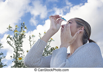 using eyedropper to treat irritated eyes