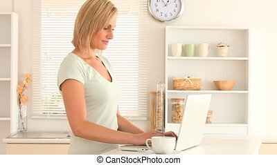 Young woman using her laptop while