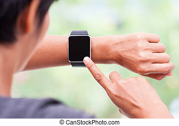 woman using her smart watch