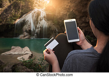 Young woman using her smartphone