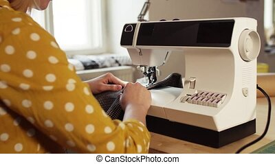Young woman using sewing machine, startup business. -...