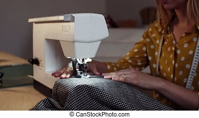 Young woman using sewing machine, startup business. - Young...