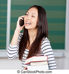 young woman using smartphone at university