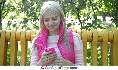 young woman using smartphone in the park