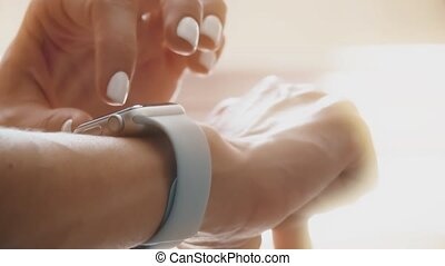 Young woman using smartwatch on her wrist