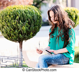 Young woman using tablet
