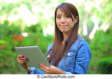 young woman using tablet touch computer