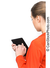 Young woman using touch pad on white background. Over shoulder view of woman holding tablet