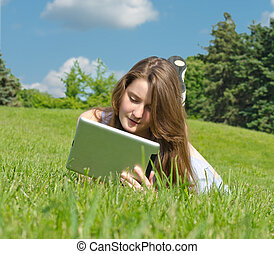 Young woman using touchpad