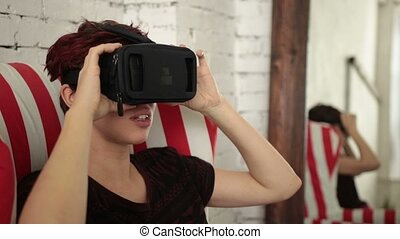 Young woman using virtual reality headset