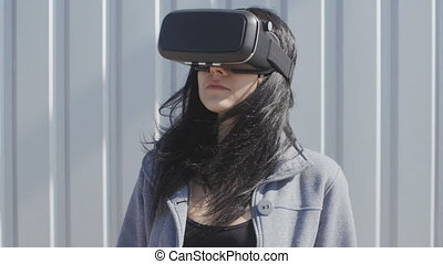 Young woman using virtual reality headset outdoor