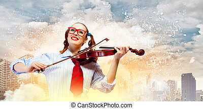 Young woman violinist - Image of young funny woman with...