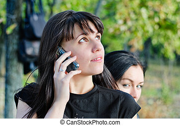 Young woman waiting for a mobile call