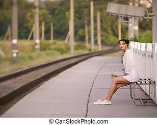 Young woman waiting for someone