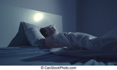 Young woman wake up with nightmare