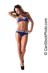 Young woman walk in blue bikini isolated