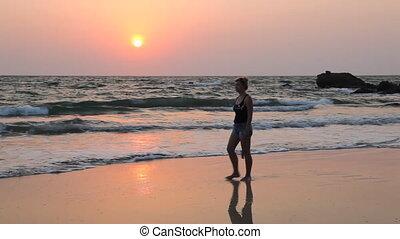 Young woman walk Ngapali beach duri - Ngapali beach, Myanmar