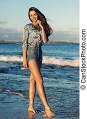 young woman walking at beach