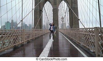 Young woman walking at Brooklyn bridge