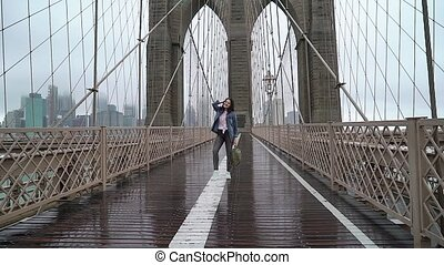 Young woman walking at Brooklyn bridge in New York