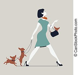 Young woman walking dogs. Fashionista with dogs
