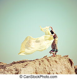 Young woman walking in a desert