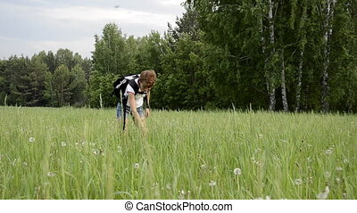 Young woman walking in a field