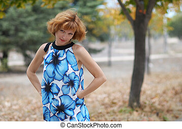 Young woman walking in autumn park