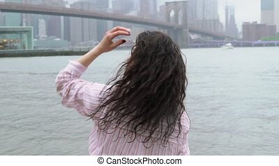 Young woman walking in New York at rain