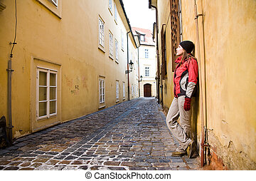 Young Woman Walking In Old City