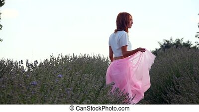 Young woman walking in the lavanda field