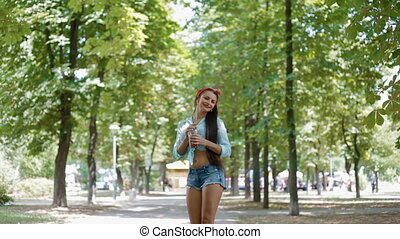 Young woman walking in the park.American style.