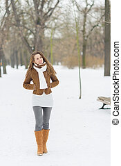Young woman walking in winter park