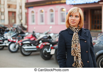 Young woman walking on a city street
