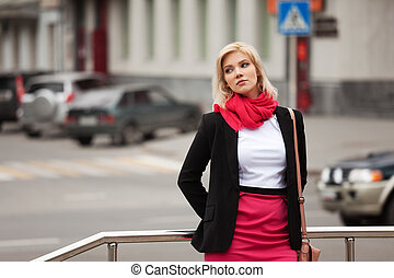 Young woman walking on the city street
