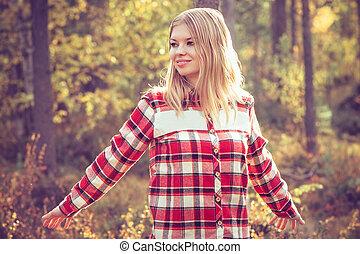 Young Woman walking outdoor wearing hipster plaid shirt...