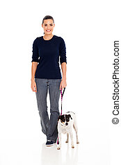 young woman walking with dog - pretty young woman walking...