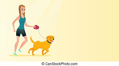 Young woman walking with her dog. - Young woman with her...