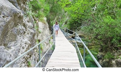 Young woman walks on observation deck. green Canyon, alanya...