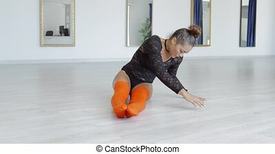 Young woman warming up while dancing